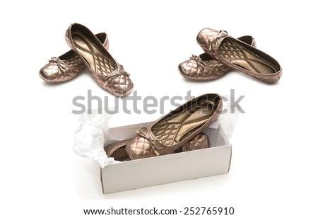 Female beige shoes on shoe box - stock photo