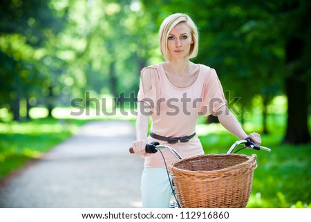Female biker in a park - stock photo