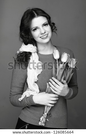 Female black and white portrait of young woman with tulips