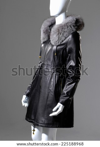 female black fur dress isolated on mannequin-gray background - stock photo