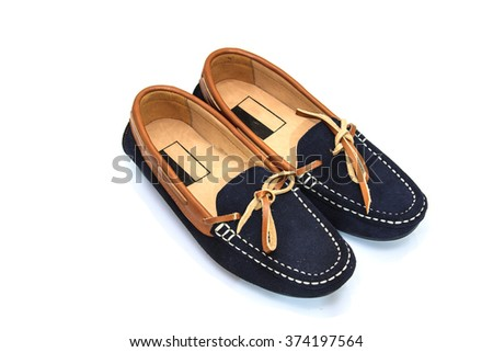 Female blue and brown leather shoes isolated on a white