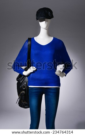 female blue clothing in jeans with bag ,hat on mannequin on light background - stock photo
