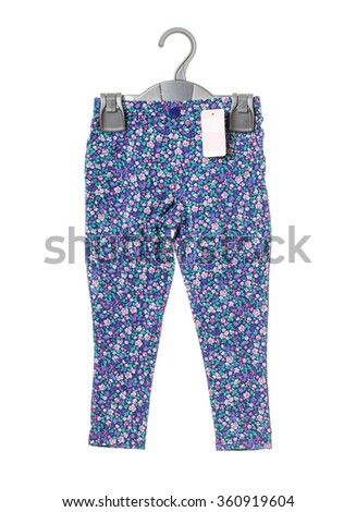 Female blue jeans with floral pattern on plastic hanger and blank price tag. Isolated on a white background.