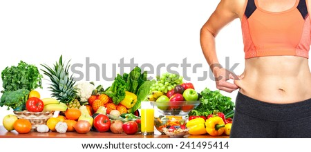 Female body fat on her abdomen. Weight loss diet and health. - stock photo