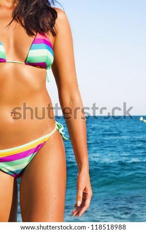 Female body on a beach background - stock photo