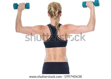 Female bodybuilder holding two dumbbells with arms up on white background - stock photo