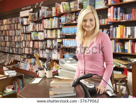 Female bookshop proprietor - stock photo