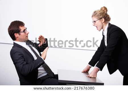 Female boss mad for employee - stock photo
