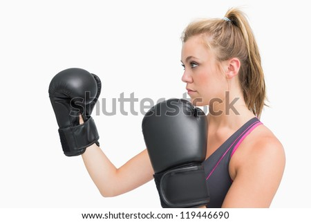 Female boxer in guard position looking tough