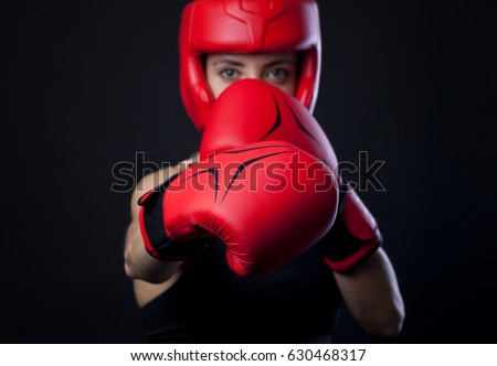 female boxer warming up before boxing match