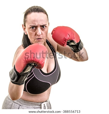 Female boxer with gloves up. Portrait on white background with copy space.