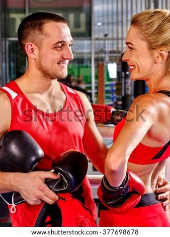 Female boxer with your male coach after workout in gym. Martial arts. - stock photo