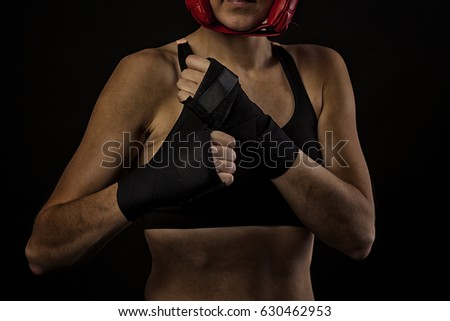 female boxer wraping hands with boxing tape