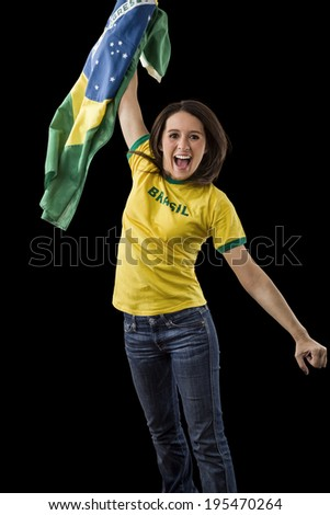 Female brazilian fan celebrating on a black background.