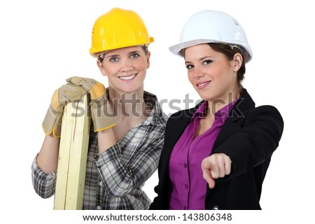 Female builder and architect - stock photo