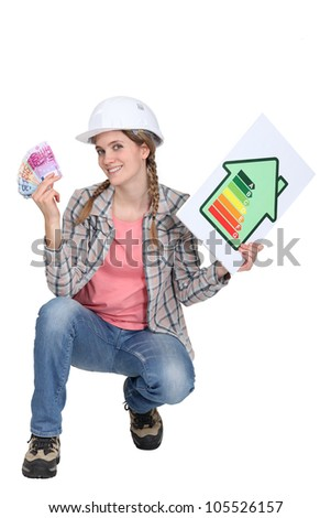 Female builder holding cash and an energy rating sign