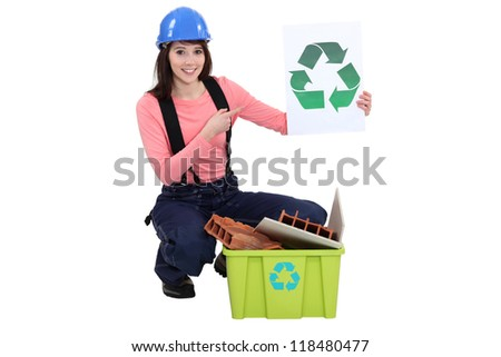 Female builder recycling waste
