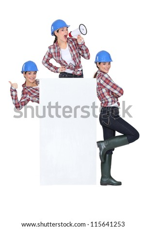 Female builder with megaphone and poster