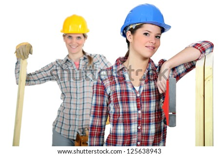 Female builders with wood