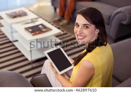 Female business executive holding digital tablet in office