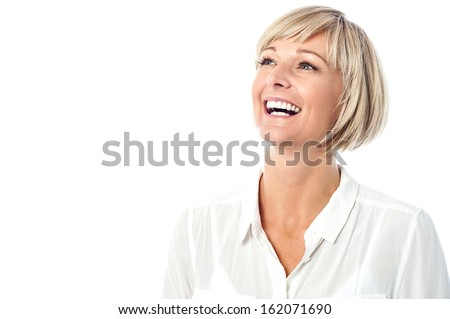 Female business executive laughing - stock photo