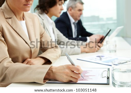 Female business lady carrying out the business data analysis