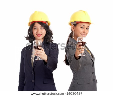 female business partner offering a glass of wine - stock photo