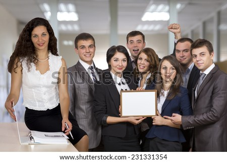 Female business trainer in front of the happy graduates who successfully passed the course - stock photo