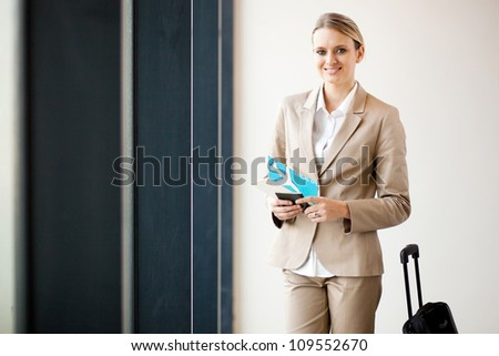 female business traveller waiting in airport - stock photo
