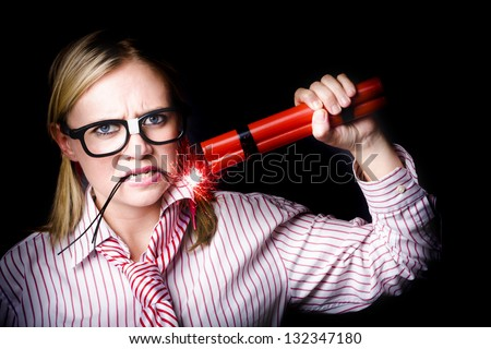 Female Businessperson holding a stick of explosives threatening strike action in a work union concept on black