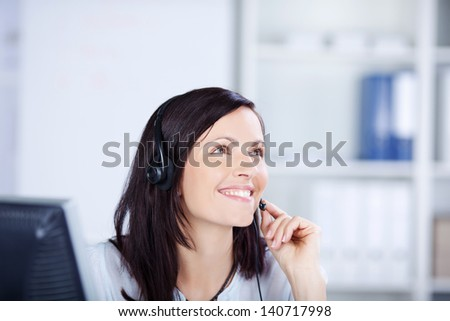 Female call center calling with her headphone