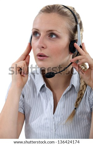 Female call-center worker taking a call from customer - stock photo