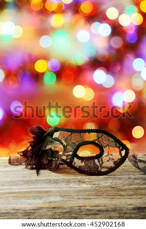 Female carnival mask on grey wooden background - stock photo