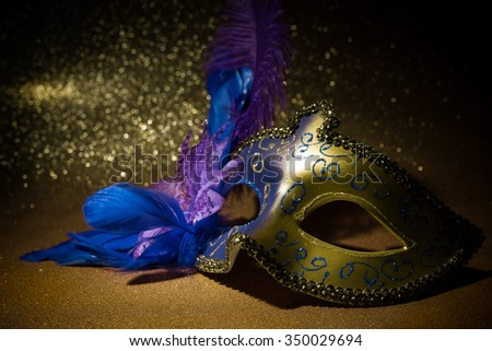 Female carnival mask over gold background - stock photo