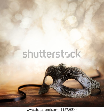 female carnival mask with glittering background - stock photo