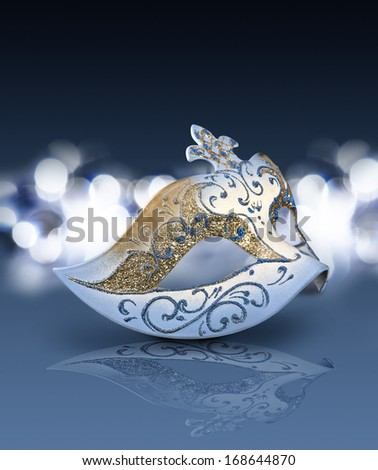 Female carnival mask with glittering background in blue mood - stock photo