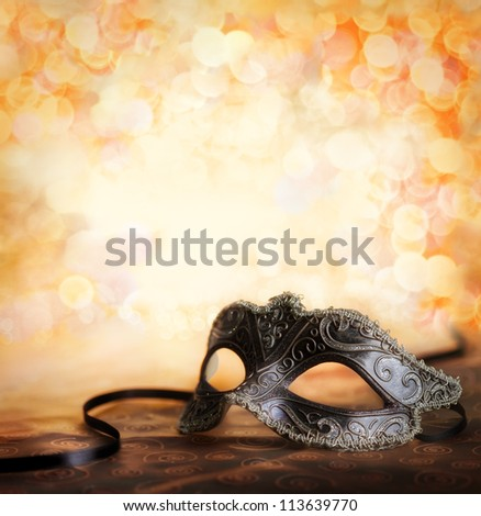female carnival mask with golden background - stock photo