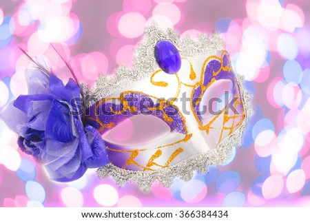 female carnival mask with pink background - stock photo