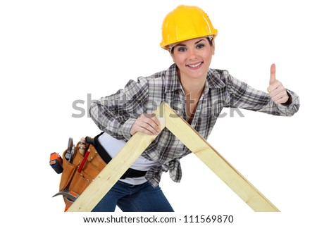 Female carpenter with truss - stock photo