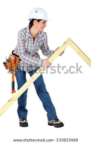 Female carpenter with wooden frame - stock photo