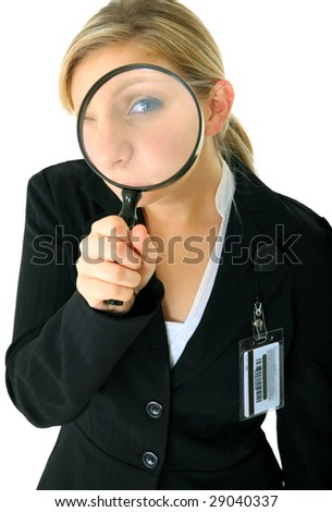 female caucasian businesswoman looking through loupe to viewer - stock photo