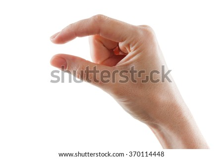 Female caucasian hand gesturing a small amount, isolated on white background. - stock photo