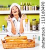 Female chef baking baguette bread - stock photo