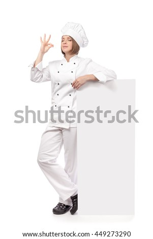 female chef, cook or baker holding spoon standing next to the banner with empty copy space for you text, making tasty gesture isolated on white background. advertisement blank board. your text here - stock photo