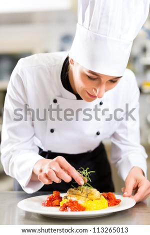 Restaurant Kitchen Chefs female chef hotel restaurant kitchen cooking stock photo 113265013