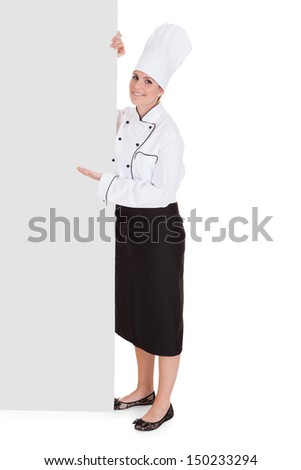 Female Chef Showing Blank Placard Over White Background - stock photo