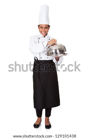 Female Chef With Tray Of Food In Hand. Isolated On White - stock photo