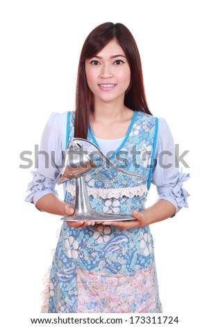 female chef with vintage crush stainless orange juicer isolated on white background - stock photo