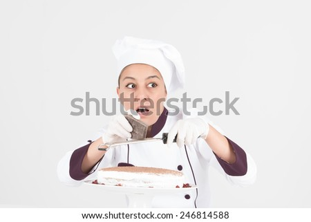 Female chef with white hat preparing dessert creamy cake with shocked expression - stock photo