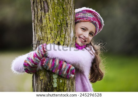 Female child hugging a tree - stock photo